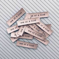 One of a kind woven garment label